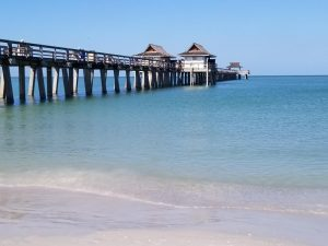 Historic Naples Pier is a free Naples attraction you can't miss while in Naples Florida. You'll love the stroll out into the ocean to watch the seagulls and even dolphins swim by. It's also a great spot to fish or have an ice cream with the kids. #naplespier #naplesflorida