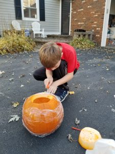 This Fall Carve Pumpkins with your kids as a fun fall activity.