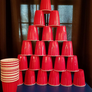 Cup Stacking - A Minute to Win It Party Game for Kids. Perfect game to play at classroom parties or family game nights. Kids can play in groups or individually racing against other kids.  They have one minute to stack & restack the cups in this fun & easy minute to win it game. #minutetowinit #kidsgame #partygame #holidaygame #classroomgame