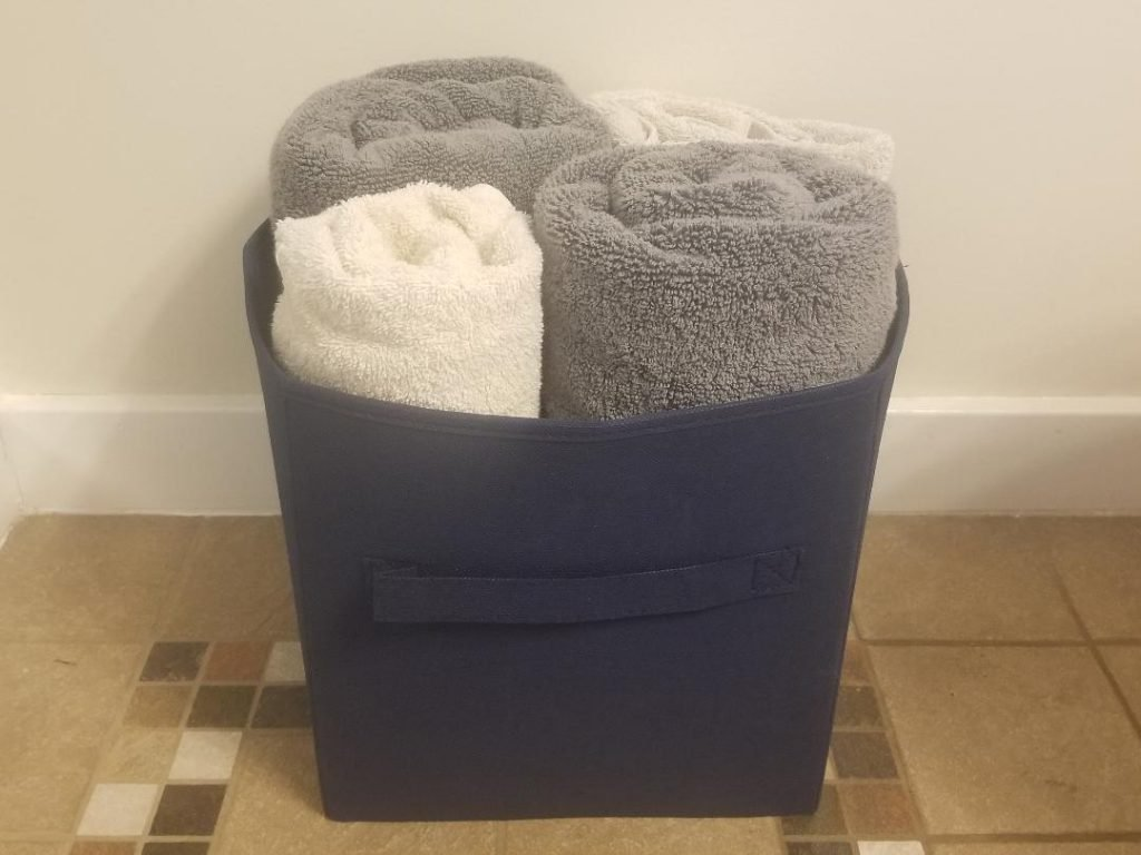 Collapsible Bin to hold folded towels to organize the bathroom