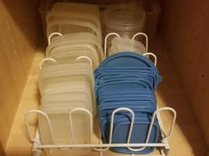 Declutter your Kitchen by Organizing your Tuperware. Stop losing tops and bottoms with a simple some simple Tupperware organization.