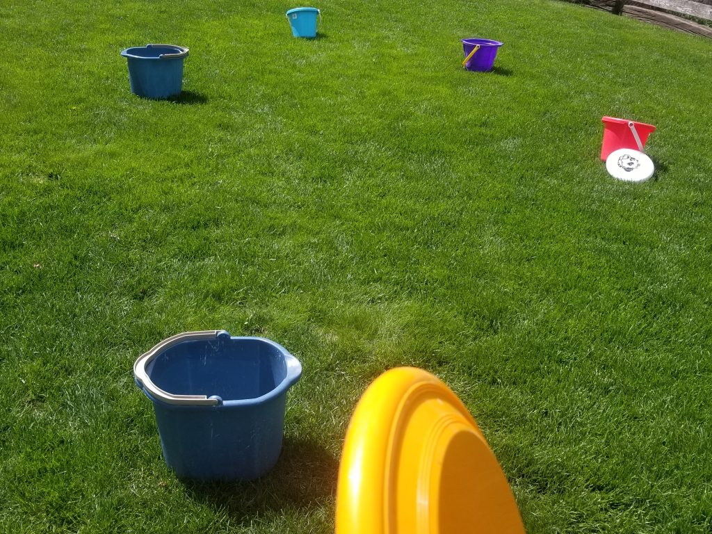 Frisbee Golf is a fun Outdoor Birthday Party Game for Kids. An easy DIY game kids will love to play in your backyard. Perfect for birthday parties too!