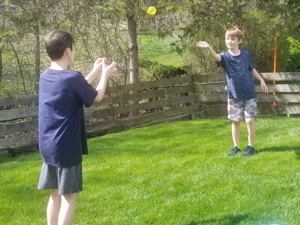 Water Balloon toss is a fun DIY backyard game kids will love to keep cool this summer.