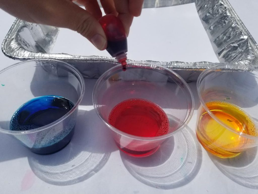 Use food dye to paint with bubbles.