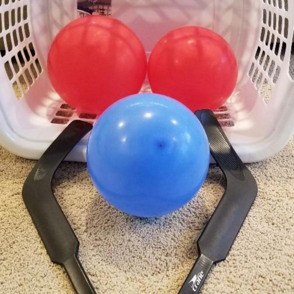 Laundry Basket Balloon Hockey a fun indoor game for kids.