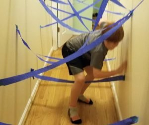 Create a cool Hallway Laser Maze as a fun kids activity when your stuck at home. An energy burning indoor activity for kids they'll love.