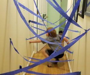 Indoor DIY Laser Maze for kids to keep them busy on rainy days when your stay indoors. #indoorgames #indooractivities #lasermaze #kidsactivities #kidsgames