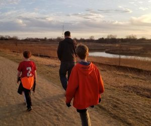 Family Bonding time on a nature walk or hike with your kids.