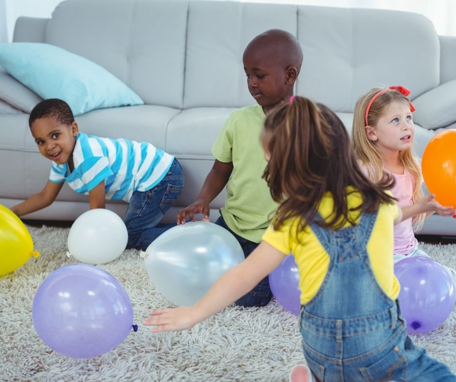 Birthday Party Balloon Stomp Game for kids. A fun and cheap games kids will have a blast playing.
