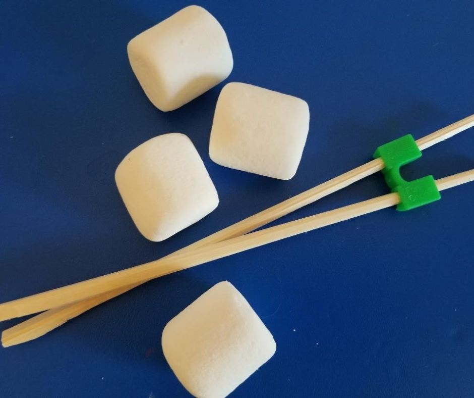 How to Play the Marshmallow Stack Minute to Win It Game for School Parties with chopsticks.