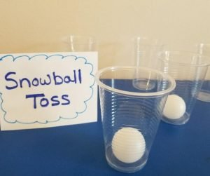 Snowball Toss is a fun Elementary Classroom Winter Party Games. Kids will love tossing these ping pong balls into the cup and seeing if they make it. A hilarious party game for kids.