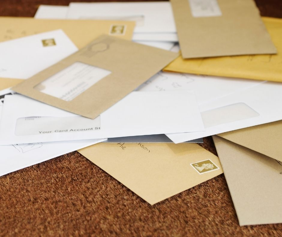 Stop the Clutter by organizing your mail at home right when you get it. Use a divider to sort your bills and other mail. Keeping it off your counters will help make your house feel clutter free.