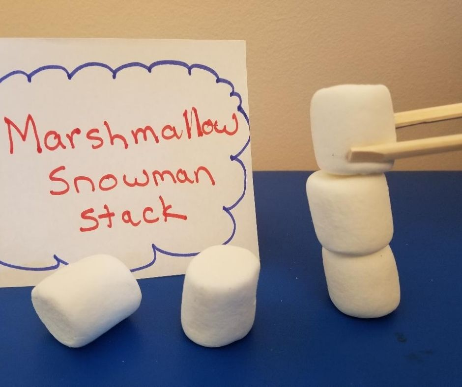 Fun School Party Game Marshmallow Snowman Stack Minute to Win It Game. Perfect for Holiday parties for kids at school or home.