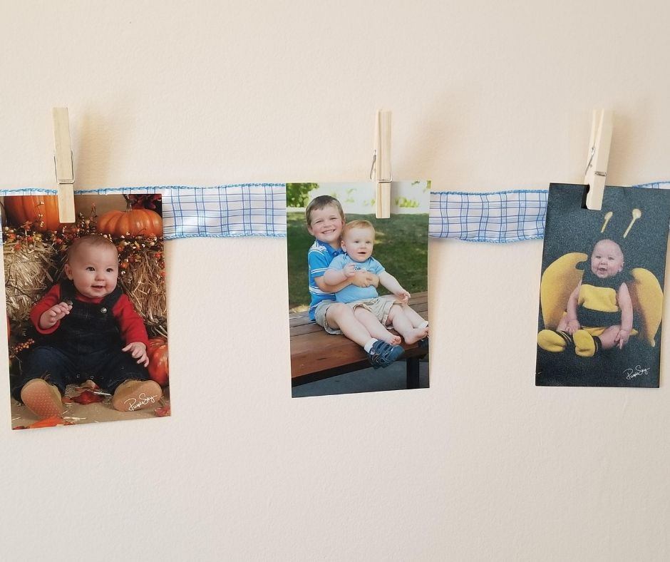 Pictures Displays for Kids Birthdays. Hang a ribbon and use wooden clips to show off kids pictures on their birthday. A meaningful family traditions kids will love.