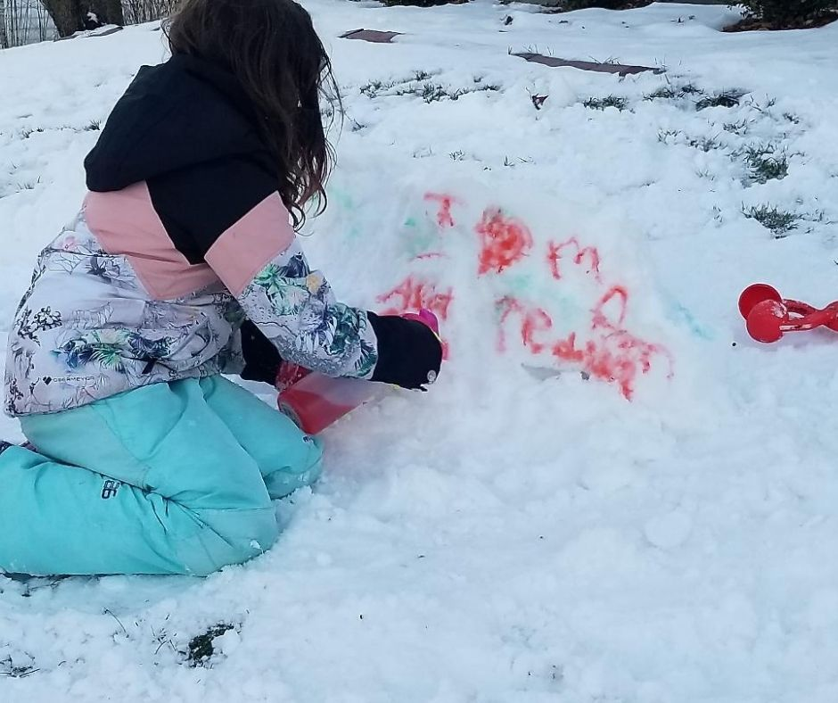 Send Messages in the Snow with Snow Paint. A cool winter activity for kids. They'll love using their creativity snow painting all their snow creation this winter. #snowpainting #snowday #winteractivityforkids