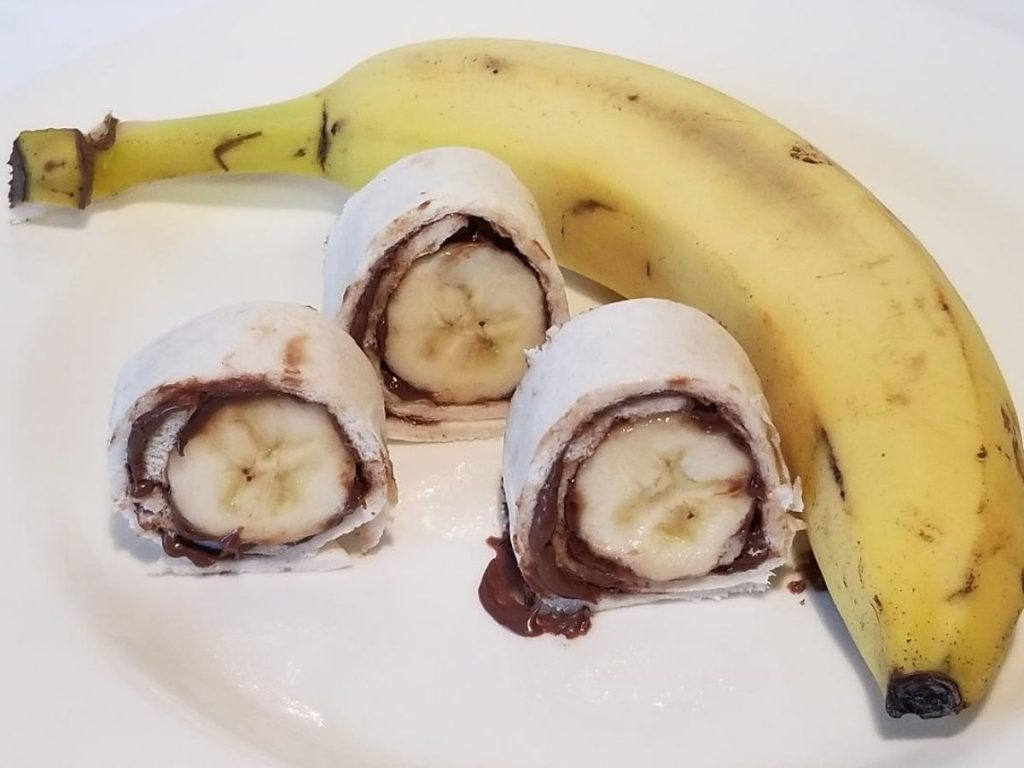 Banana Sushi is a fun After School Snack for Kids. This easy snack ideas uses bananas, tortilla and Nutella or peanut butter. Simply spread Nutella or peanut butter on tortilla, wrap up the banana and cut into sushi pieces. It's sure to become a favorite snack.