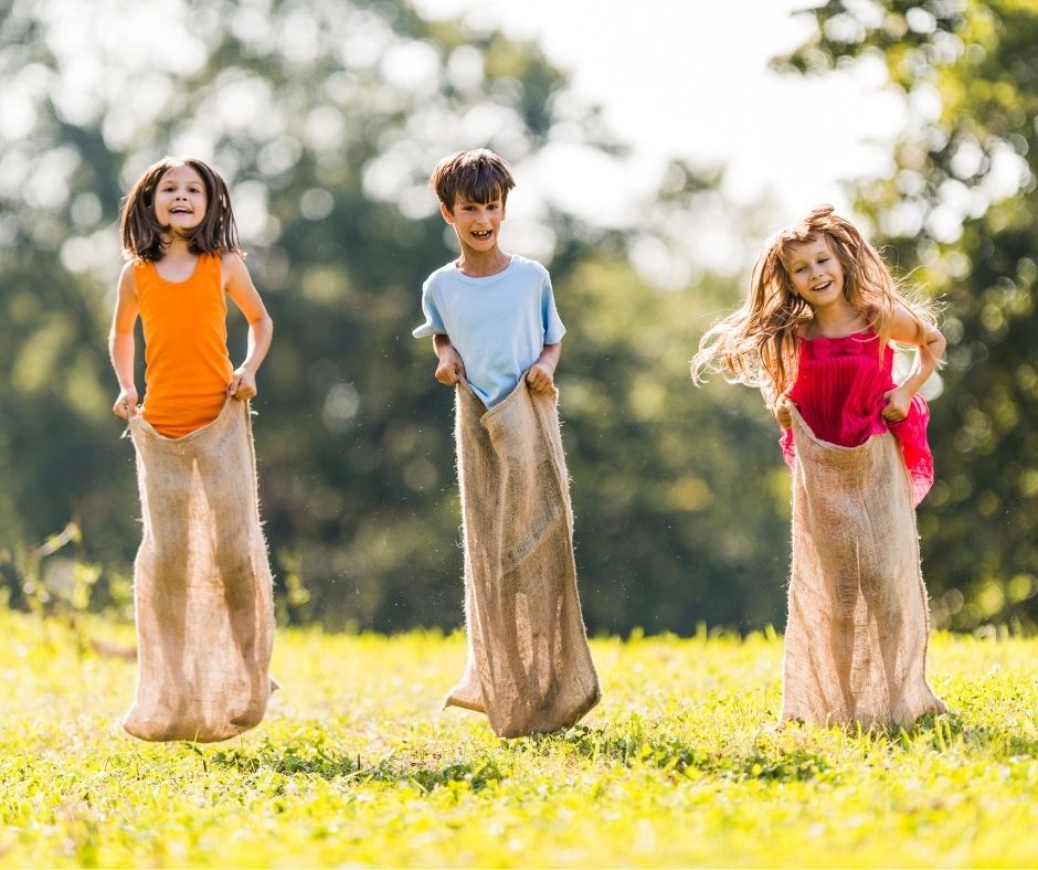Sack Races are a fun Outdoor Birthday Party Game for Kids to play in your backyard.