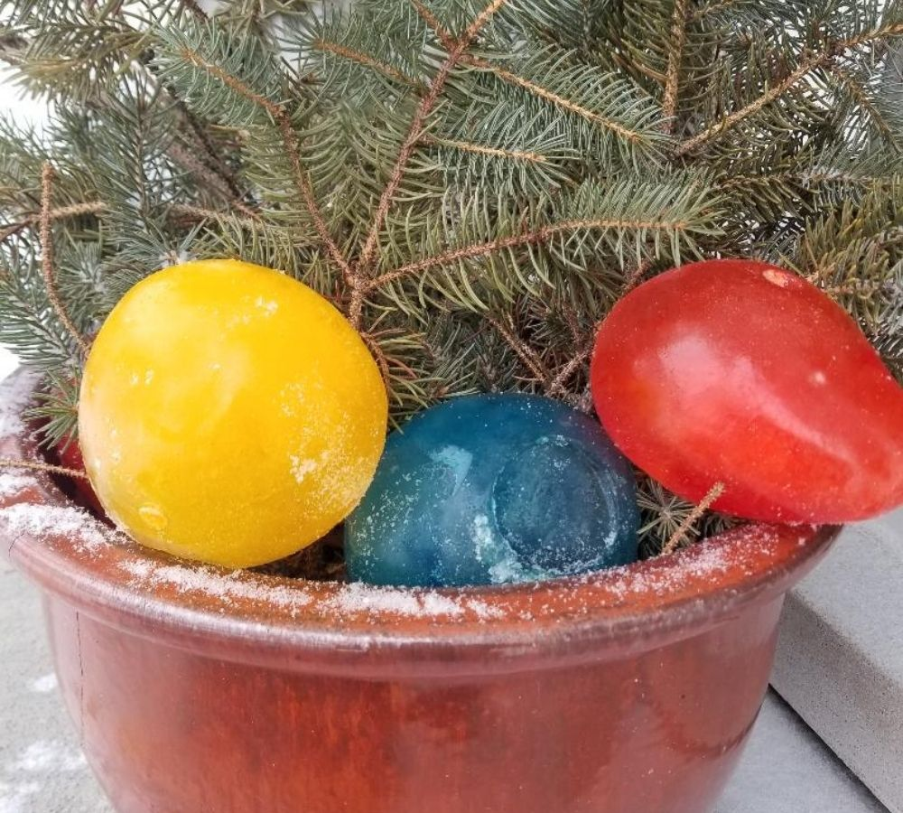 Winter Outdoor Pots decorated with colored Ice Balloons.
