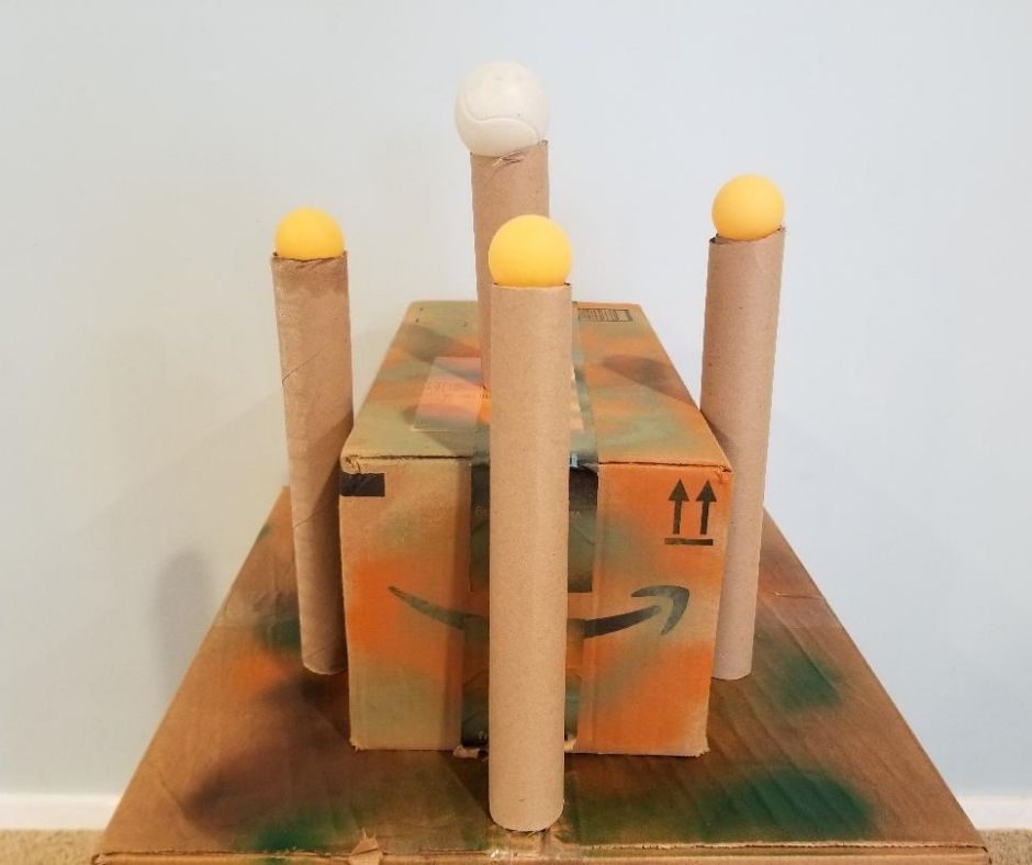 DIY Nerf Targets with paper towel rolls and ping pong balls.