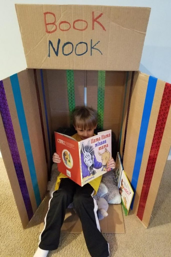 Cardboard Reading Nook or Play house for Kids. A fun indoor playhouse for kids made with cardboard boxes. When your done collapse the box and put it away. Fun on rainy days when your stuck at home.