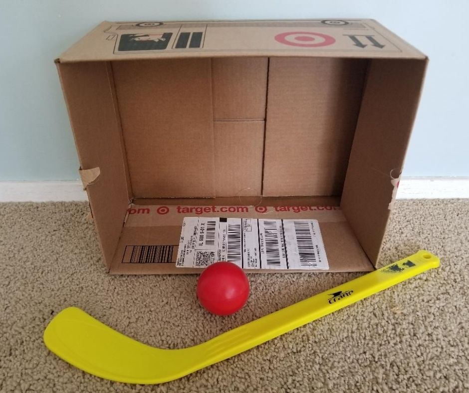 Indoor Cardboard Box Hockey for Kids. Play indoor hockey by using a cardboard box and hockey sticks. Keep your kids active when your stuck indoors.