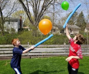Balloon Keep It Up with Pool Noodles and Balloons. A fun game to play on rainy days at home or as a cool party game. A cheap and entertaining game kids will love with Dollar Tree supplies.
