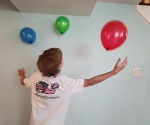 Keep it Up Bubble Challenge is a fun Minute to Win It game for teens. Kids try to keep 3 balloons up in the air for 1 minute without any touching the floor.