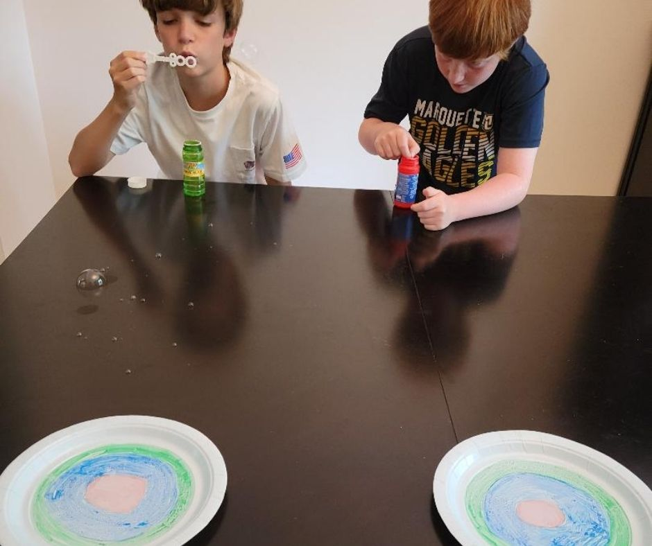 Fun Bubble Minute to Win It Game with bubbles and paper plate target. Easy game for kids & teens parties and family game night.