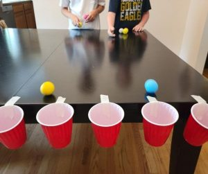 Drop in the Cup is an easy & challenging Minute to Win it Game for tweens at school parties.