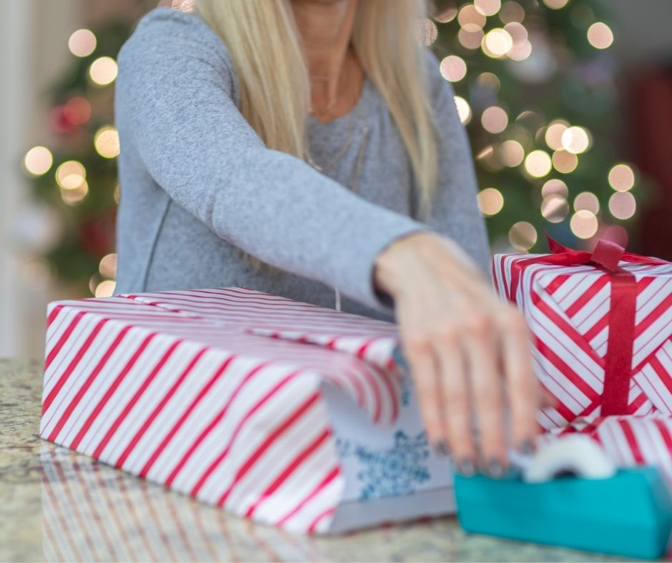Who Can wrap the gifts the fastest? A fun Minute to Win It Christmas Challenge for Holiday parties.
