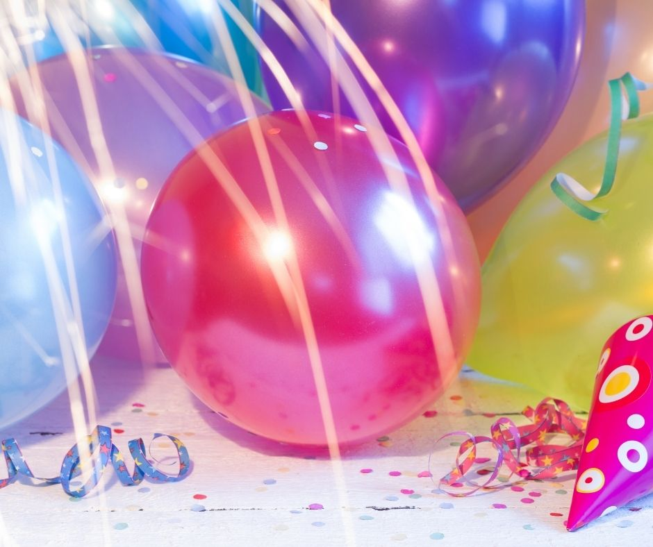 DIY Balloon Drop for a New Year's Eve with Kids. A fun thing to do for at family New Year's parties. They'll love this easy balloon drop with a plastic tablecloth, balloons and tape.