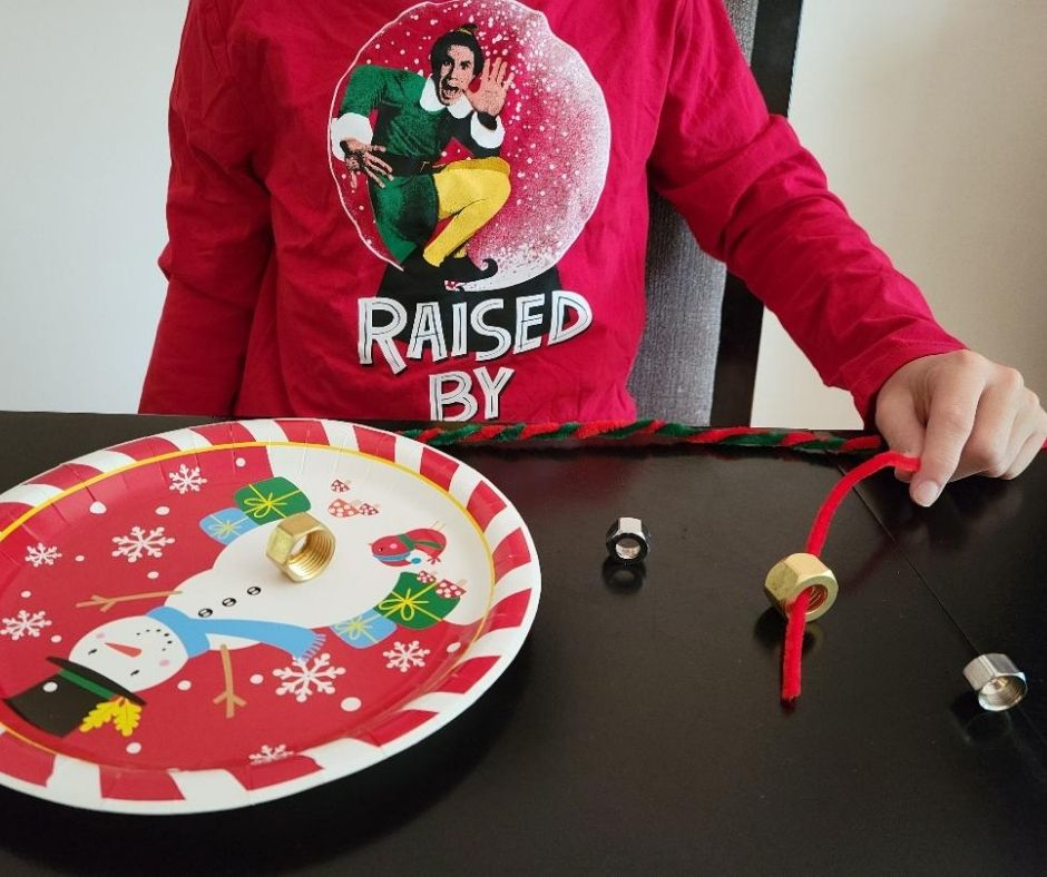 Quick Minute to Win It Game Pipe Cleaner Pick Up. A fun Christmas Party games for families.
