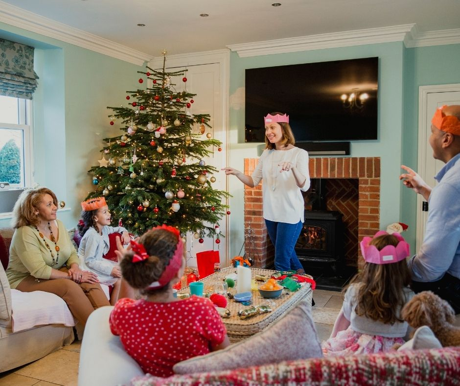 Play Christmas Charades for a fun family game night at Holiday Parties.